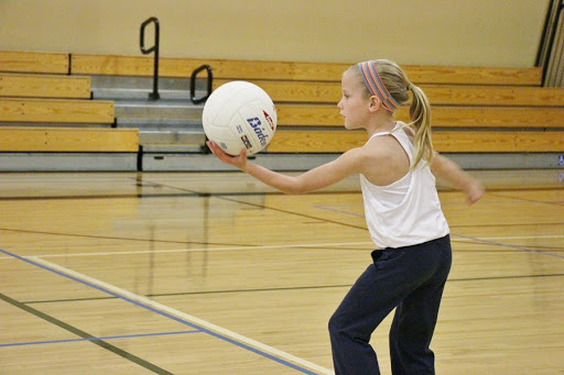 Little girl with volleyball